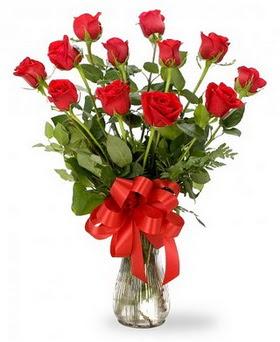 Kırşehir çiçekçi telefonları  12 adet kırmızı güllerden vazo tanzimi