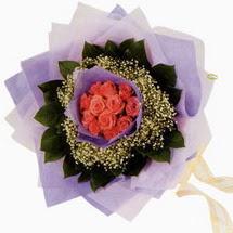 12 adet gül ve elyaflardan   Kırşehir ucuz çiçek gönder