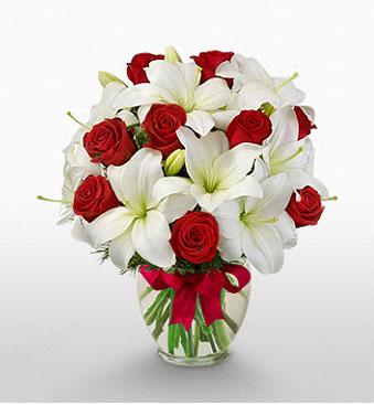 Kırşehir çiçek , çiçekçi , çiçekçilik  1 dal kazablanka 11 adet kırmızı gül vazosu